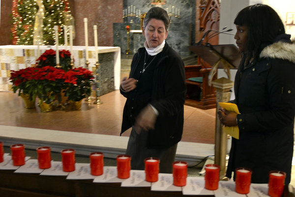 At the 2011 Vigil, Sr. Helen showed Samantha Tunsil the candle for Hanief Bailey, a friend of a relative of Tunsil's who was killed in Nov. of that year (TOM GRALISH / Philadelphia Inquirer Photographer)