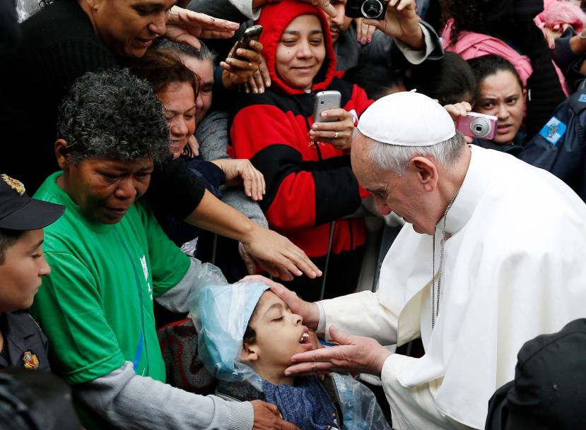 "Pope Francis visits a ""favela,"" or slum, on the outskirts of Rio."