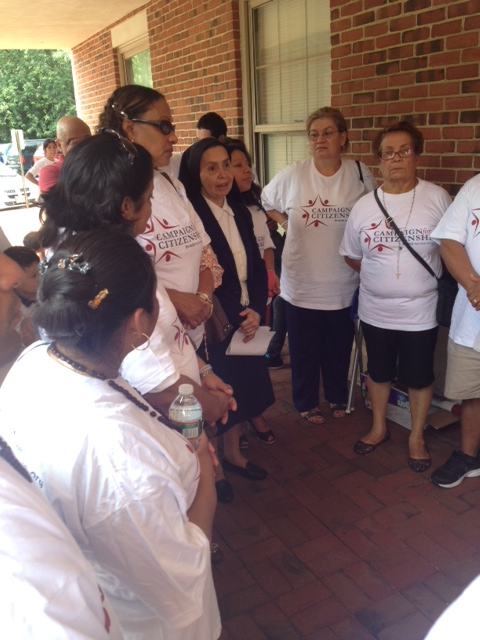 S. Graciela, center, who serves immigrant communities at Holy Cross Parish in Bridgeton, debriefs our meeting with Rep. LoBiondo at the vigil outside his office Friday.