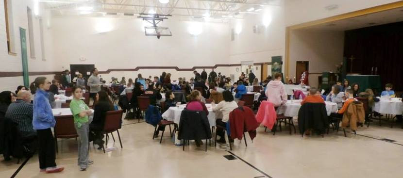 Faith Festival participants gather for the integenerational activity.