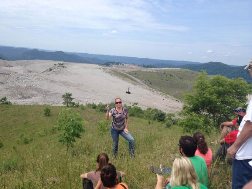 Elise Keaton from the Keeper of the Mountains organization describes the effects of mountaintop removal coal mining. The barren landscape in the background was a lush mountain before it was mined.
