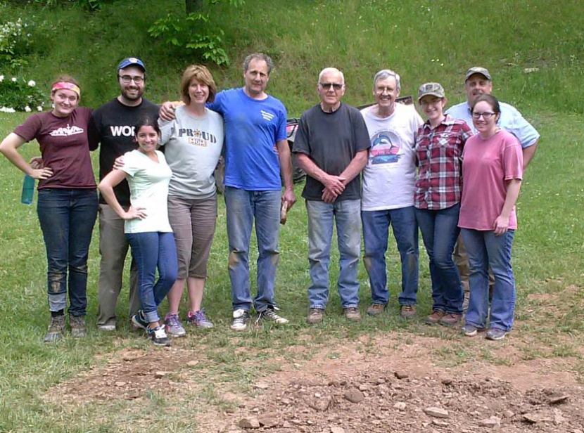 Diocese of Camden pilgrims to West Virginia worked with local resident Ron Hutson (fifth from right) on a repair project during their stay at Nazareth Farm. From left to right: Nazareth Farm staff member Annika Darby; pilgrims Mike Jordan Laskey, Yanelis Fernandez, Donna Mills and Steve Mills; Ron Hutson; and pilgrims Jim Steintz, Amanda Dupras, Roger Asselta, and Geneva O'Brien.